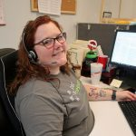 Amanda smiling at the camera, happy to be working in call center