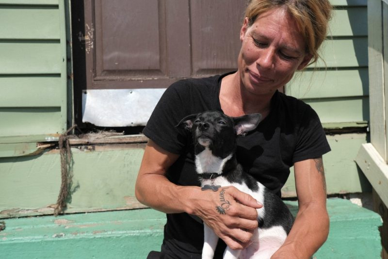 Janet, with her puppy, Maverick, who survived parvo after receiving treatment at PRCKC.