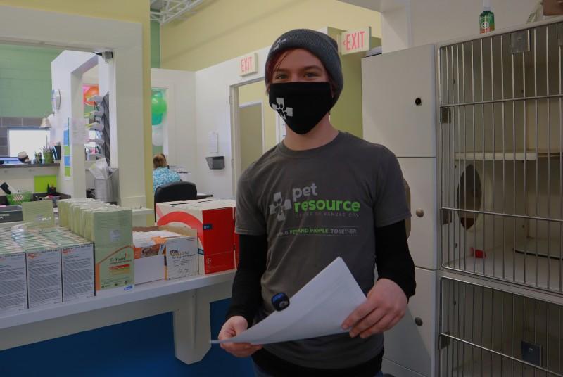 Pet Resource Center of Kansas City teammates meet before the day gets underway.