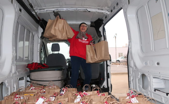 Getting ready to hand out holiday gift bags.