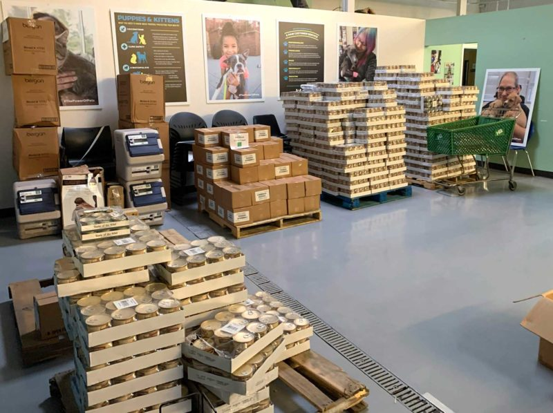 A room full of pallets of pet food.