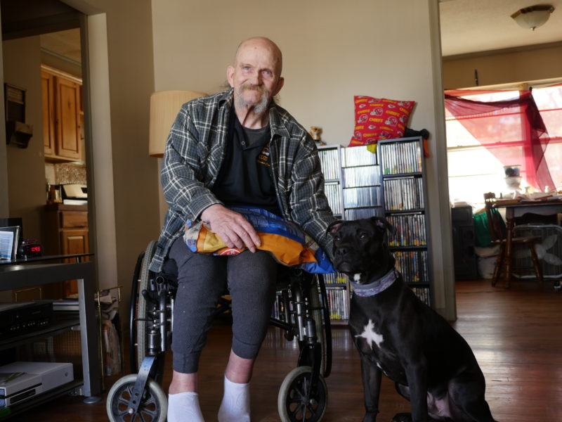 Gary sits with his new friend, Bear, a rambunctious dog with a heart of gold. Gary says Bear saved his life.