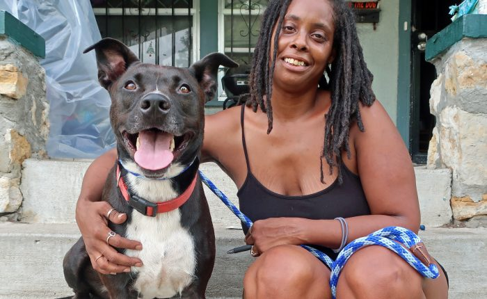 Woman and dog happily smiling at the camera