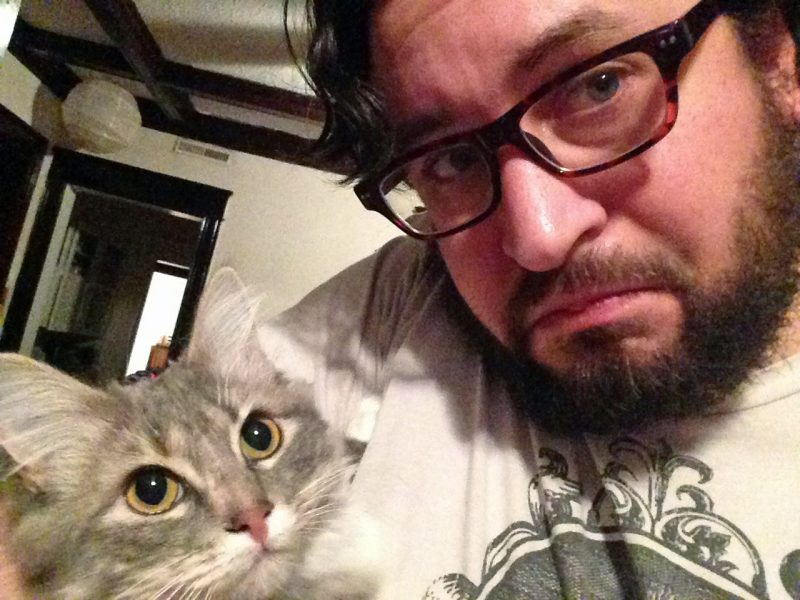 man takes selfie with cat