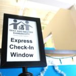 A sign for an express check-in window