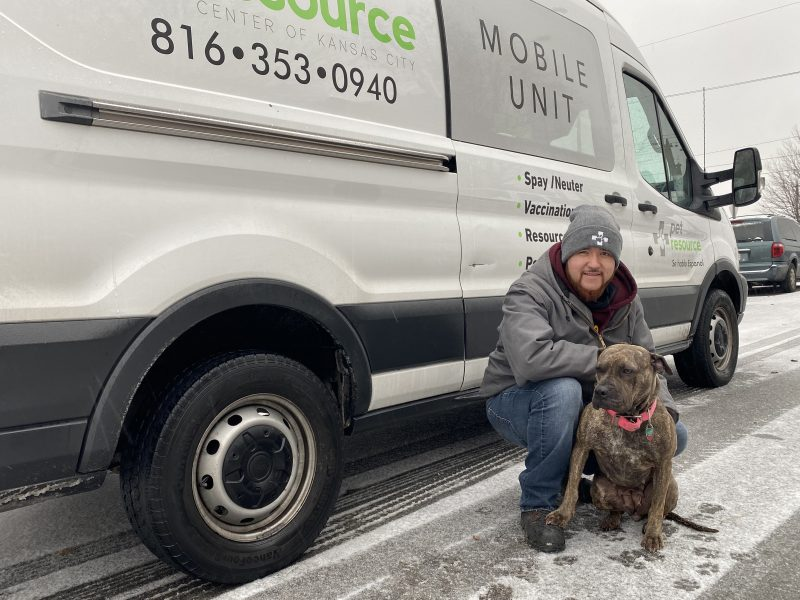 outreach team member with dog in snow
