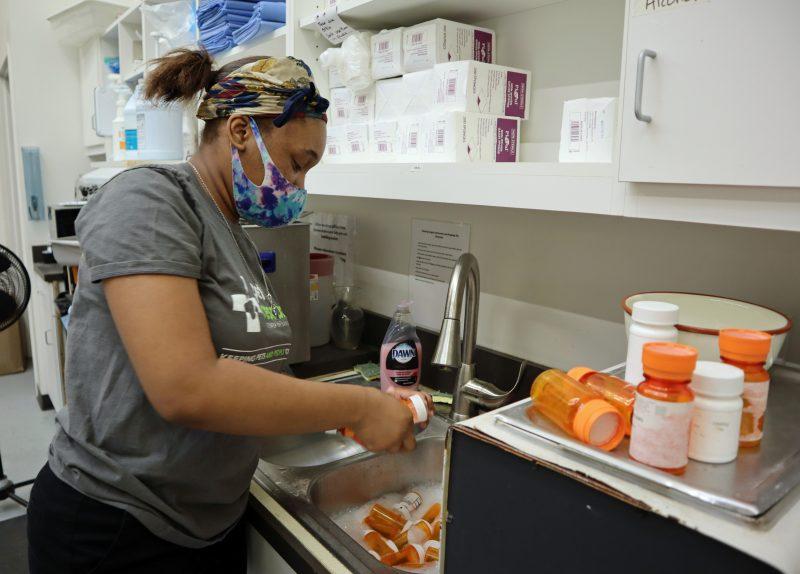 high school intern cleaning pill bottles