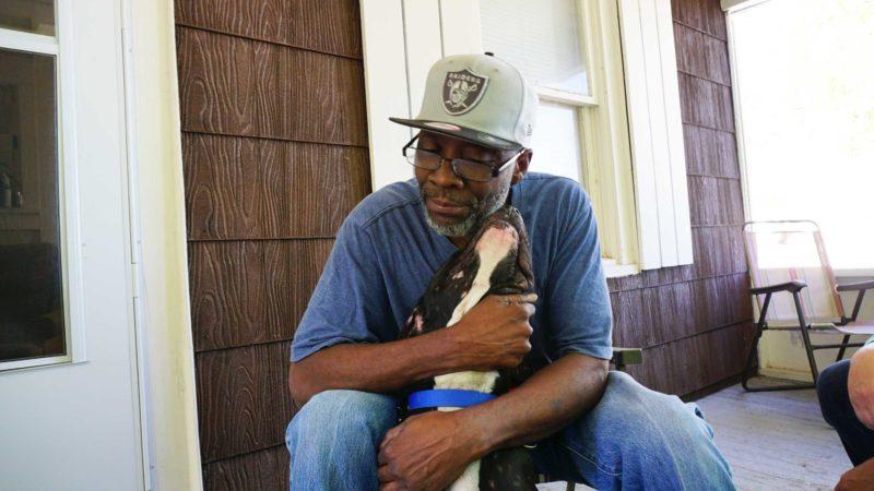Mr Smith hugs his dog Beast